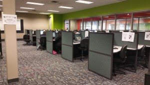 an array of grey cubicles in an office
