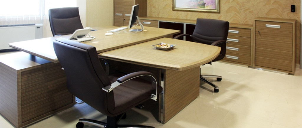 a multi-purpose desk with three chairs