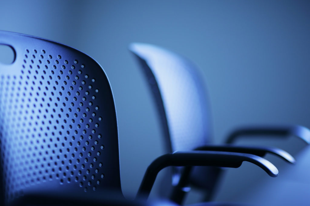 Modern office chairs detail, shallow DOF.